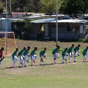 Kids from Bontebok Primary School warming up